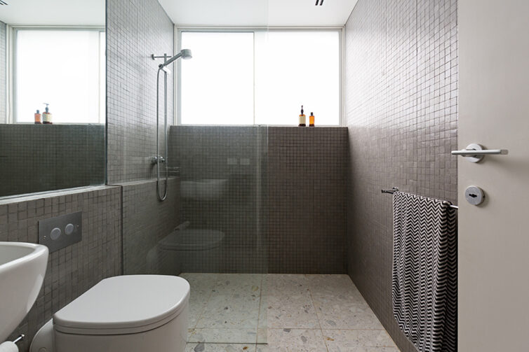 Modern walk in shower with mosaic tiles