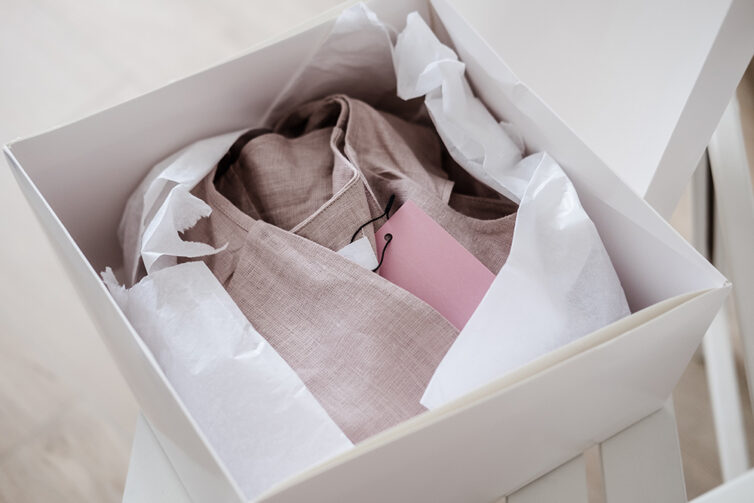Linen clothing wrapped in box