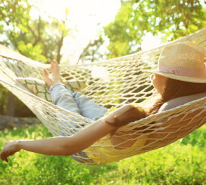 Women with hat. Relaxing in hammock