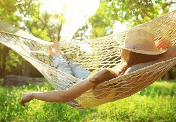 Women with hat. Relaxing in hammock