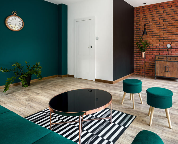 Stylish appartment with green sofa and dark glass coffee table