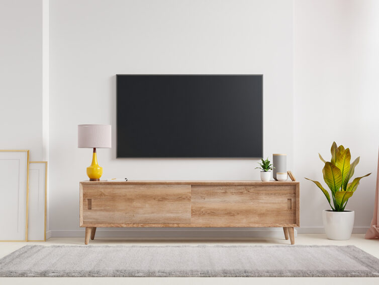 TV mounted to the wall above sideboard in living room