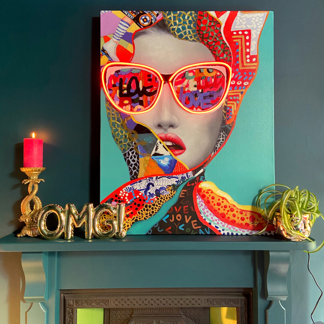 Gianna LED Neon Canvas Art £265. Ornate Leaping Fish Candle Holder £32.95. Gold OMG Balloon Ornament & Wall Décor £38.95.