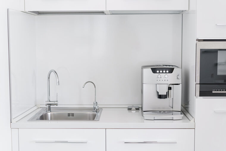 Kitchen with coffee machine and built in water filter