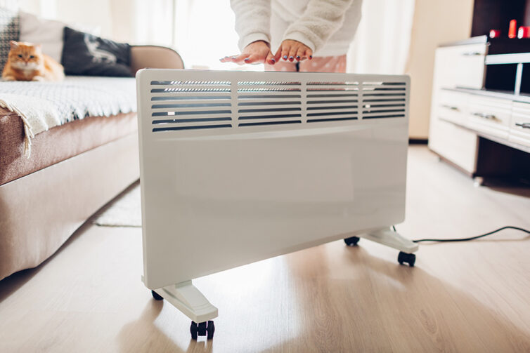 Electric radiator on wheels in living room