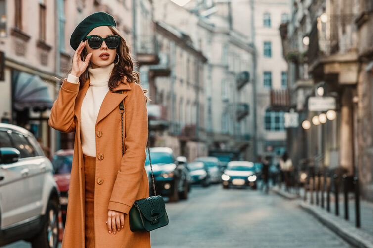 Women with fashionable coat, sunglasses and beret