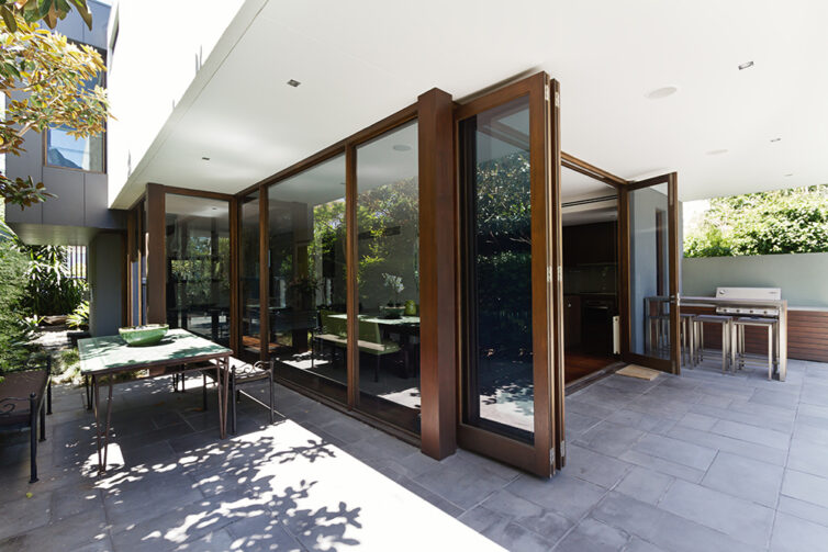 Bi folding doors opening to rear courtyard of contemporary open plan home