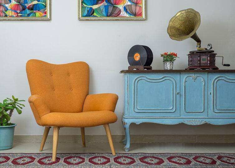Orange retro chair. Vintage Gramophone. Upcycled, repainted blue sideboards.