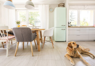Scandi Kitchen with wooden dining table and mix of retro inspired chairs