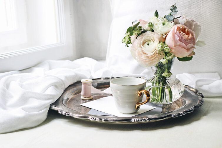 Roses in vase on silver tray. Vintage look.