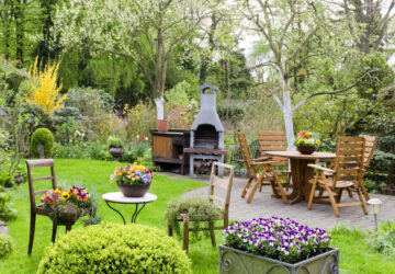 Garden with wooden furniture and pizza oven