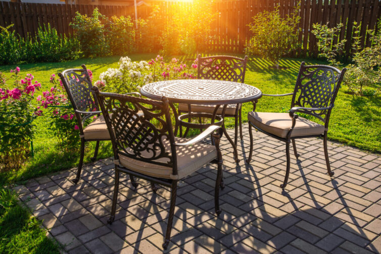 Metal garden table and chairs with comfy cushions