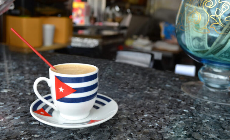 Expresso coffee in cup with Cuban flag