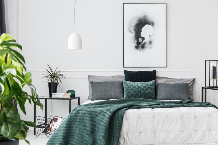 Large bedroom with white, black, grey and green colouring.