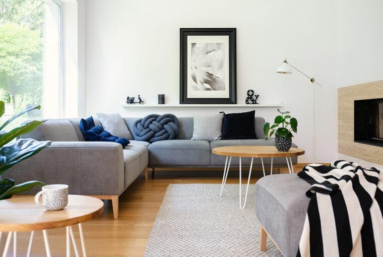Grey corner Sofa in white room and wooden floor