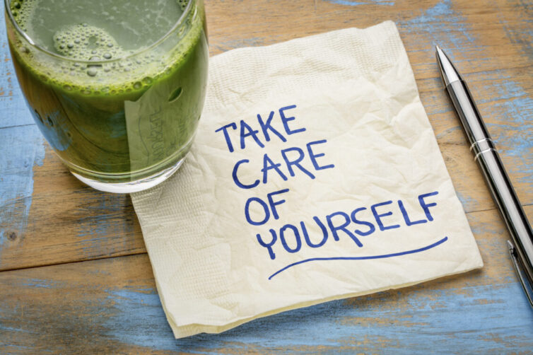Take care of yourself written on napkin next to green juice