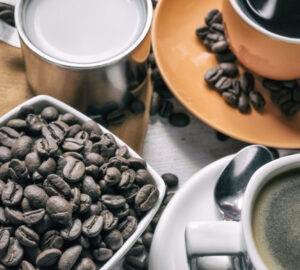 Coffee beans and coffee in cups