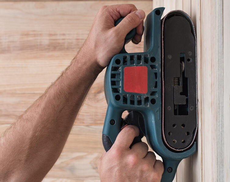 Sanding wood with electric sander