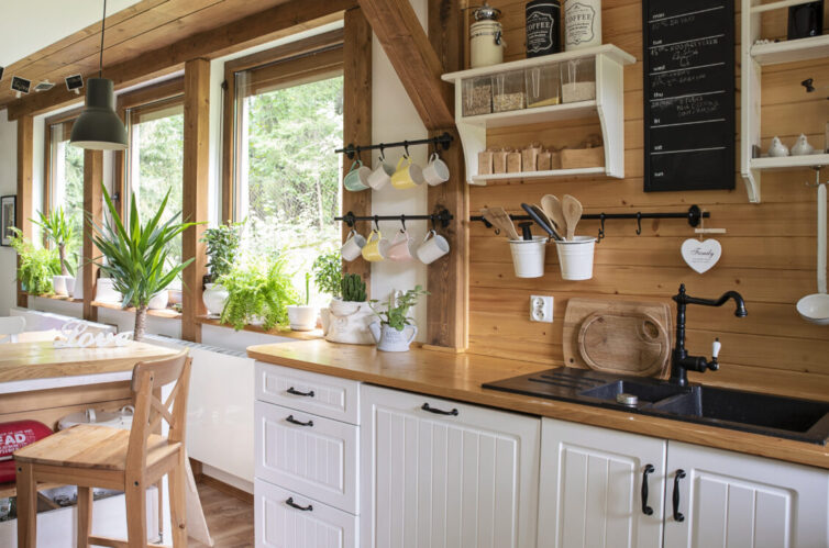 Country kitchen with white cupboards and wooden worksurfaces