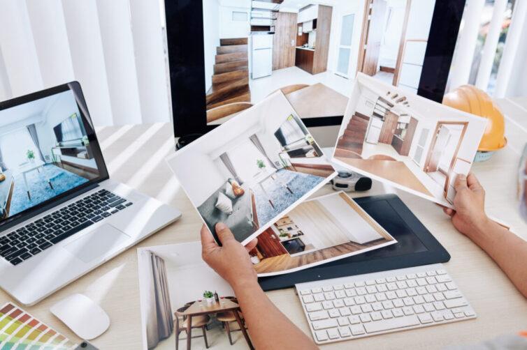 Looking at printed photos of  room renovation ideas