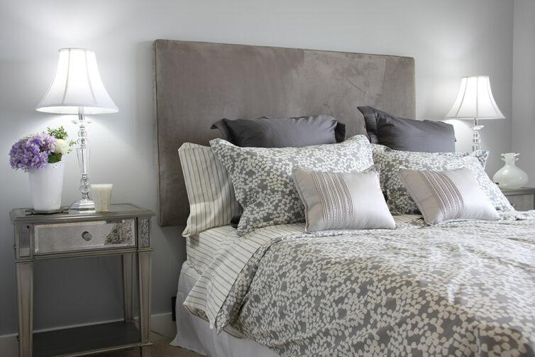 Stylish grey and glass bedroom