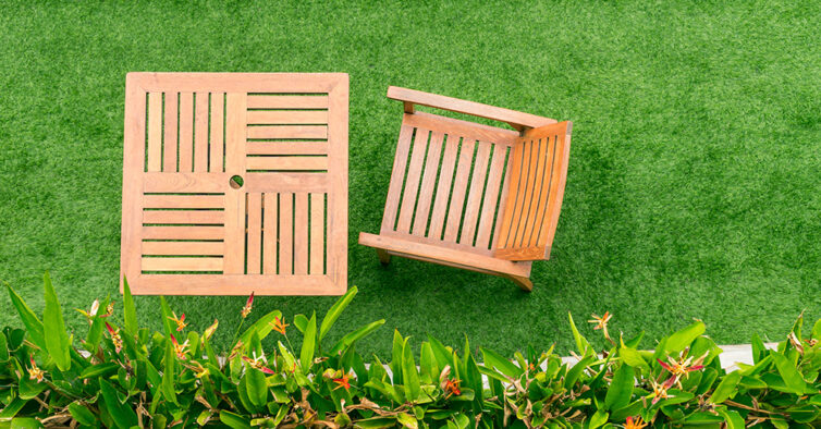 Artificial grass with wooden table and chairs