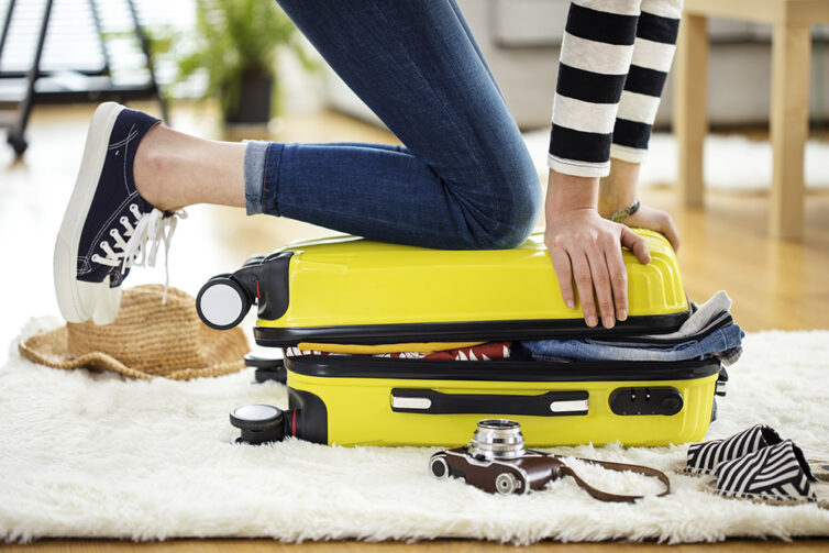 Yellow over full suitcase