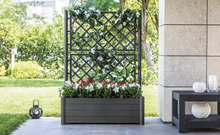 Large planter with decorative trellis.
