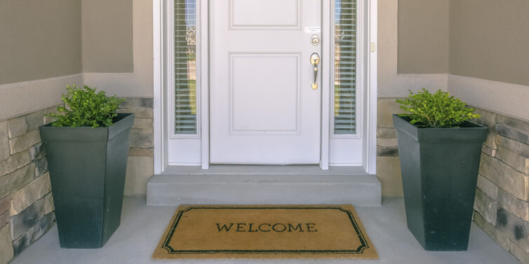 Entrance to house with welcome doormat