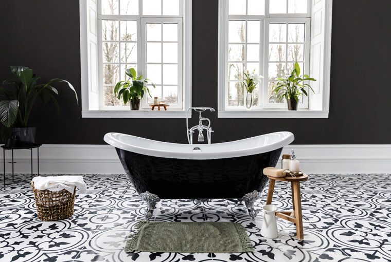 Bathroom with black painted walls and black roll top bath