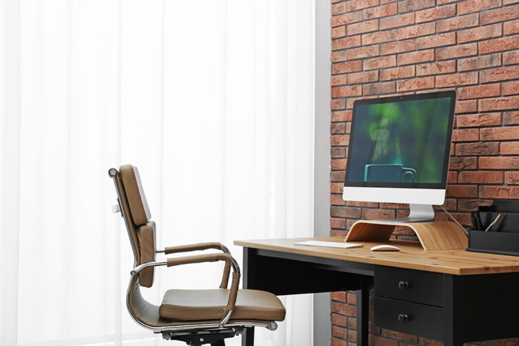 Home office with office chair, desk and apple computer