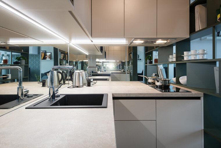 Small white kitchen with glass splashback