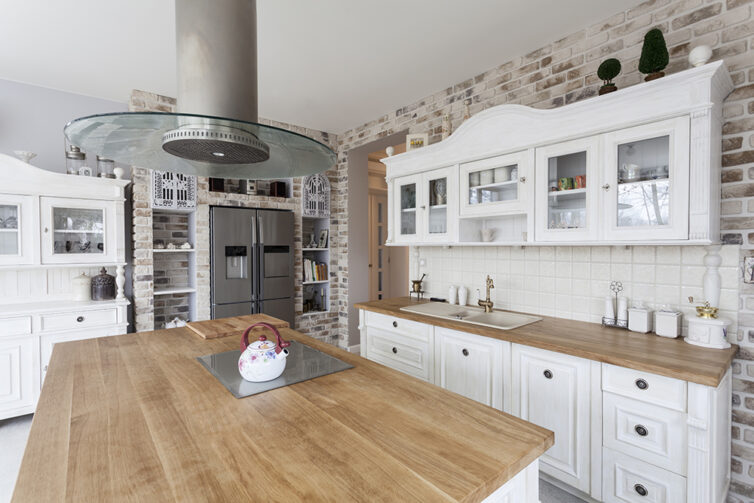 White kitchen with wooden worksurfaces