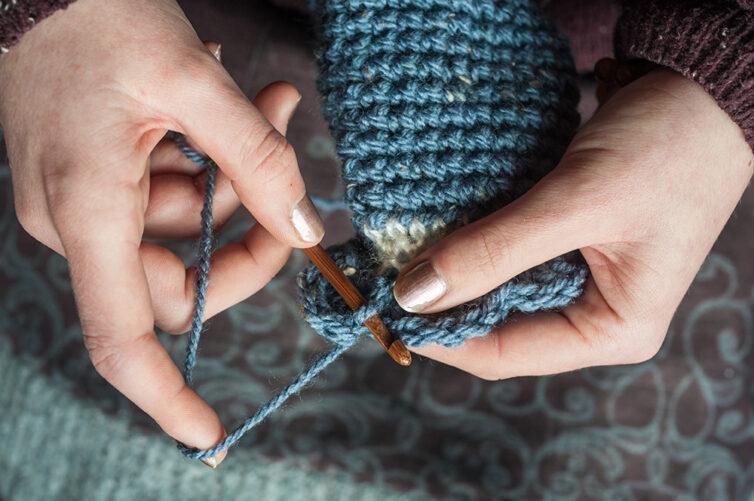 woman's hands crocheting