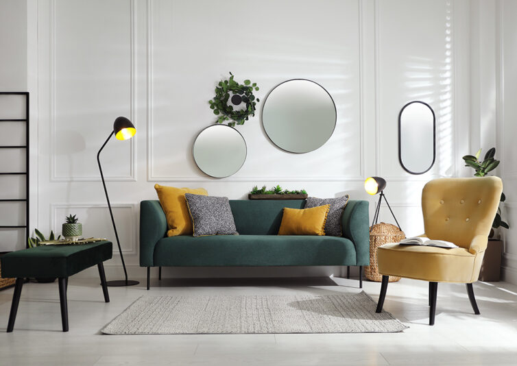 Loung with dark green sofa and mustard coloured slipper chair