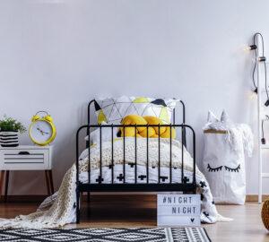 Black and yellow bedroom. Designed around black metal bed