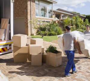 Removal company delivering sofa and boxes to new home with box van